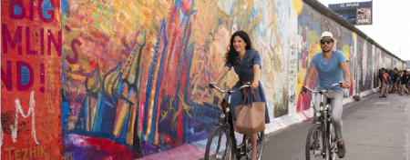 riding the bike along the Berlin wall