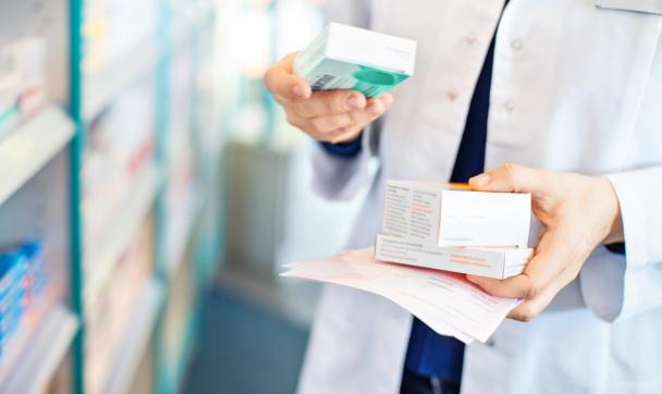 pharmacist holding medication in her hand