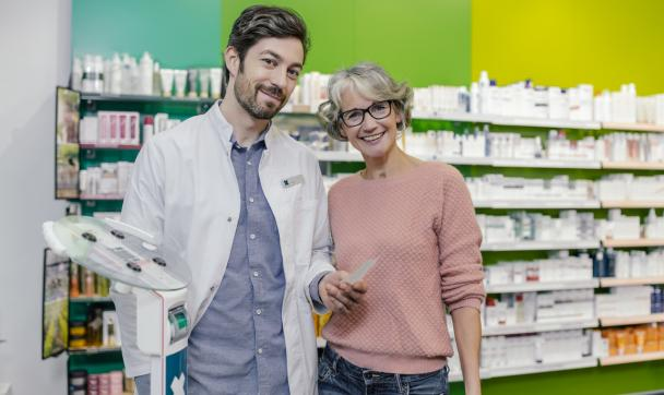 pharmacist and his customer smiling