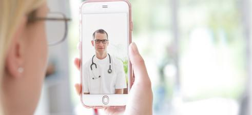 patient talks via her iphone to the doctor in a video consultation